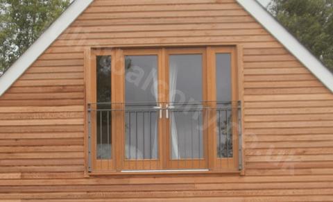 photo: Vantage balcony on the outside of a house