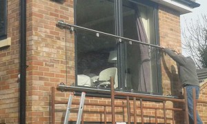 Installing the balcony glass 3