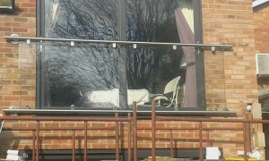 the balcony glass in place