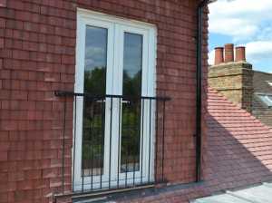 photo: Oxford metal balcony in front of French doors