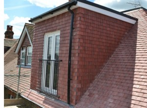 photo:  Oxford metal balcony fitted to tile hung dormer window