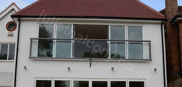 photo: a 6.3m wide custom glass juliet balcony