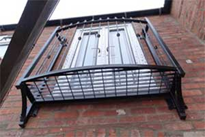 photo: small platform steel balcony