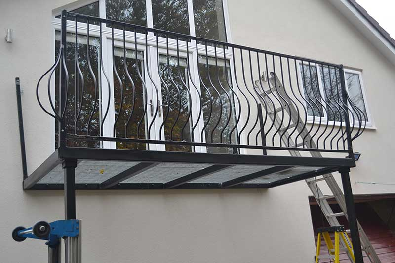 photo: Large Steel Balcony being fitted
