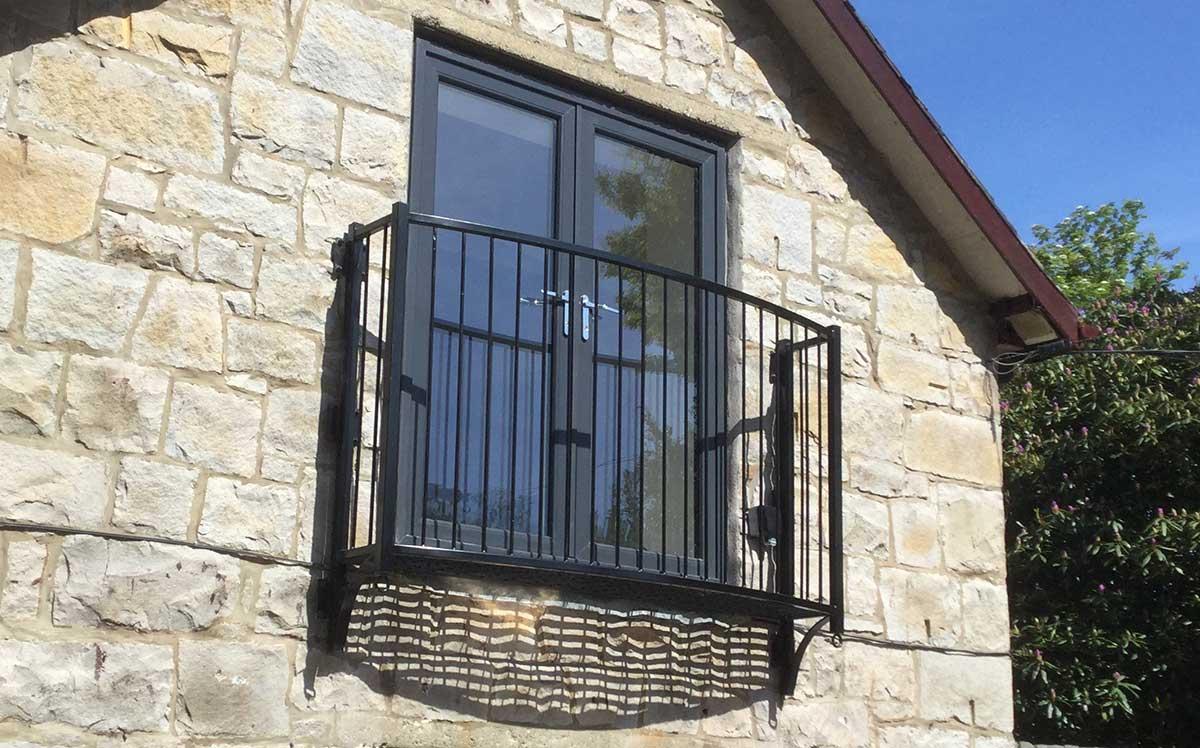 photo: small platform steel balcony with no finials